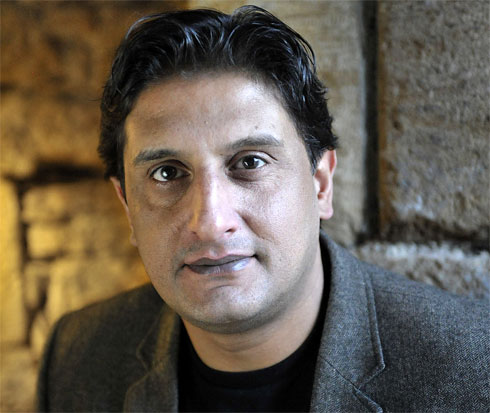Photo of Ishy Din, writer of 'Snookered'